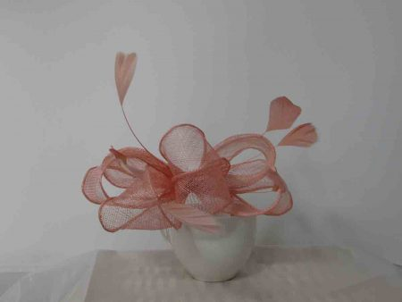 Looped sinamay fascinator in light pink