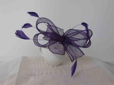 Looped sinamay fascinator in purple