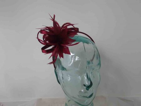 Satin fascinator with feathers flower in burgandy