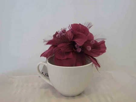 Feathered fascinator in deep peony
