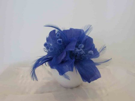 Feathered fascinator in forget me not blue