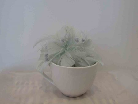 Feathered fascinator in glacier mint