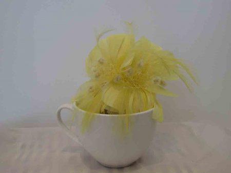 Feathered fascinator in lemon yellow