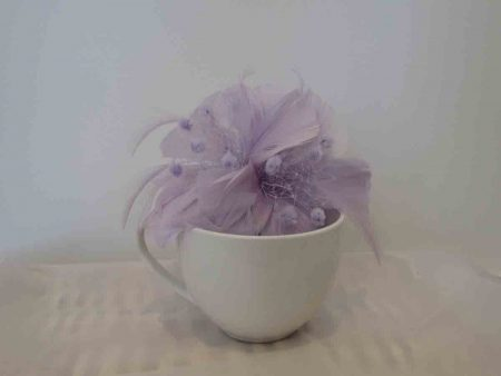 Feathered fascinator in ice lilac