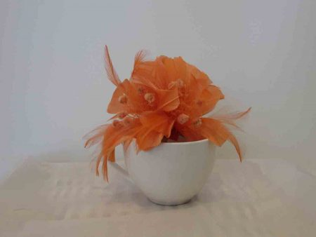 Feathered fascinator in melon orange