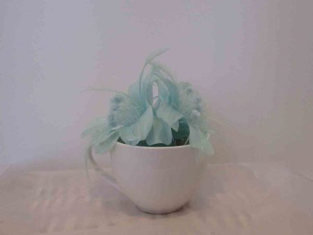 Feathered fascinator in mint sorbet