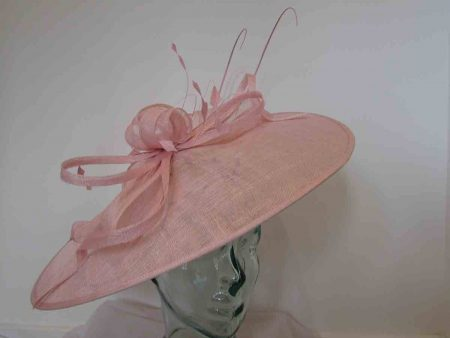 Oval hatinator with sinamay bow in chalk pink