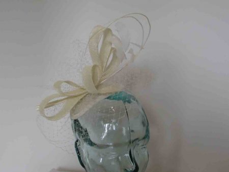 Looped sinamay fascinator with veiling in