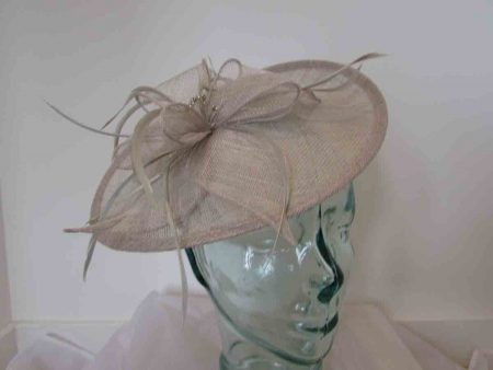 Hatinator with sinamay flower and diamante centre in almond