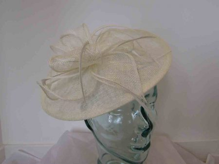 Hatinator with sinamay flower and diamante centre in ivory