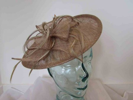 Hatinator with sinamay flower and diamante centre in latte