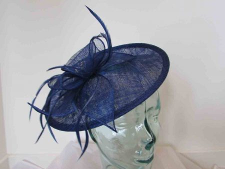 Hatinator with sinamay flower and diamante centre in marine blue