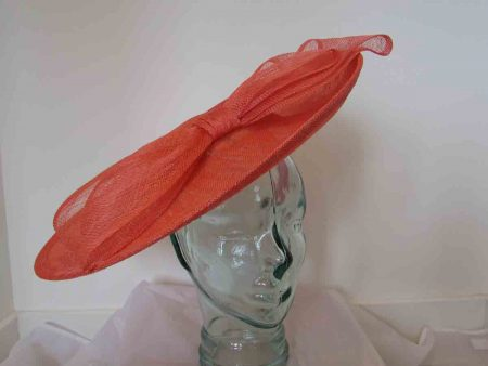 Large hatinator with bow in tangerine orange