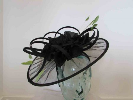 Net black fascinator with large flower and green feathers