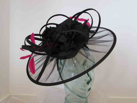 Net black fascinator with large flower and pink feathers