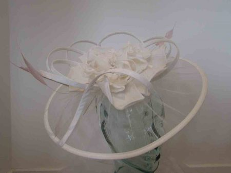 Net ivory fascinator with large flower and light pink feathers