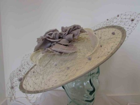 Ivory hatinator with taupe flower and trim