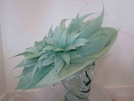 Large sinamay hatinator with feathered flower in powder pink