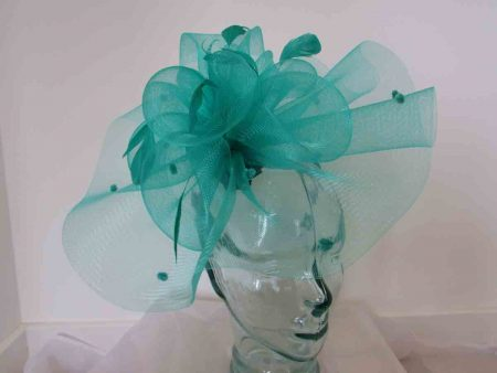 Crin spotted fascinator in miami green