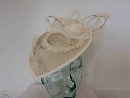 Leaf disc fascinator in champagne and ivory