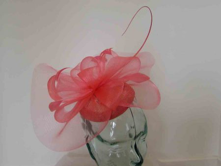 Pillbox fascinator with netting in coral
