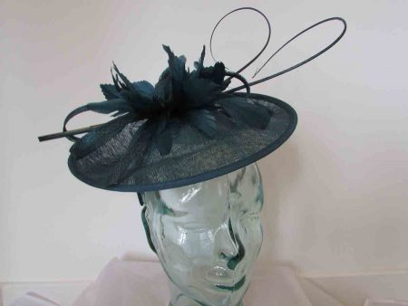 Curicular hatinator with feathered flower in teal