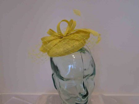 Pillbox with veiling in daffodil yellow