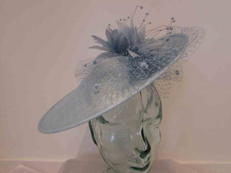 Large disc hatinator with feathered flowers in air blue