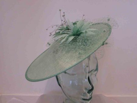Large disc hatinator with feathered flowers in apple green