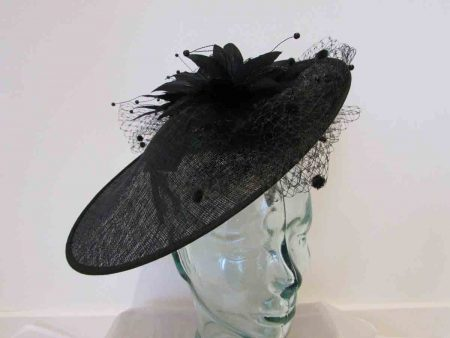 Large disc hatinator with feathered flowers in black