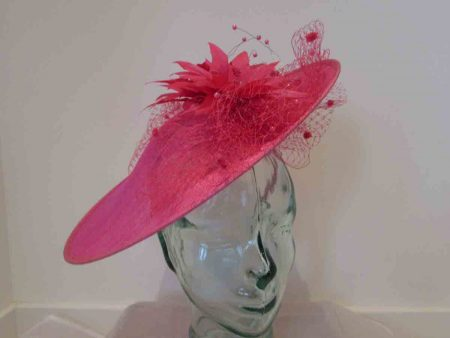 Large disc hatinator with feathered flowers in fandango pink