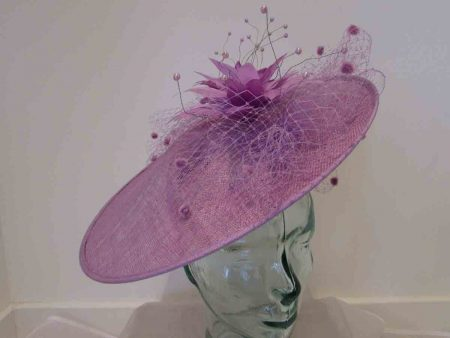 Large disc hatinator with feathered flowers in orchid purple