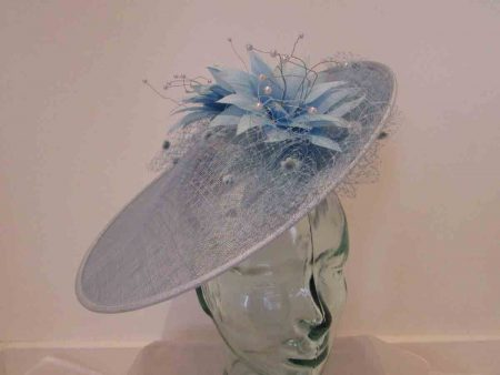 Large disc hatinator with feathered flowers in sky blue