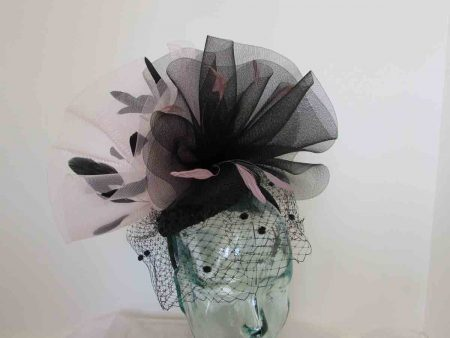 Dramatic pillbox with veiling in black and light pink