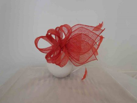 Sinamay fascinator in coral