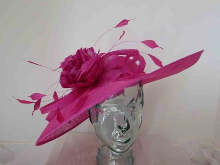 Sinamay hatinator with feathered flower in magenta pink