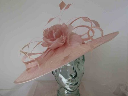 Sinamay hatinator with feathered flower in pink lurex