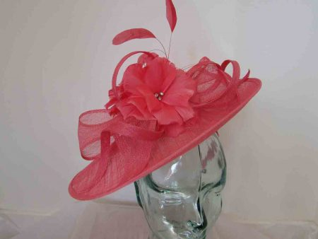 Sinamay hatinator with double feathered flower in flamingo pink