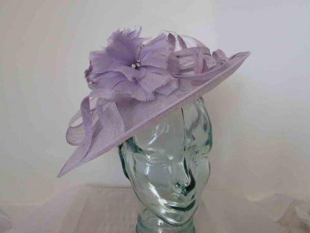 Sinamay hatinator with double feathered flower in iced lilac