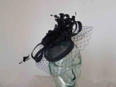 Pillbox fascinator with netting and flowers in navy