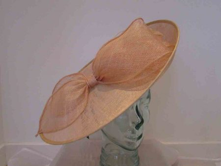 Large hatinator with sinamay bow in apricot