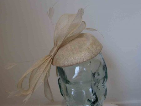 Sinamay pillbox fascinator with bow in metallic champagne