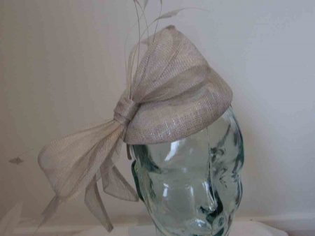 Sinamay pillbox fascinator with bow in metallic pearl