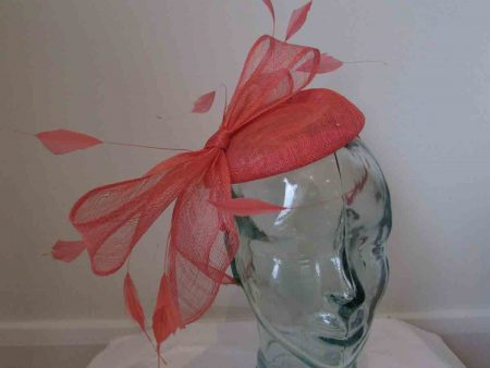 Sinamay pillbox fascinator with bow  tangerine orange