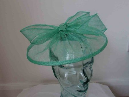 Sinamay fascinator with sinamay bow in miami green
