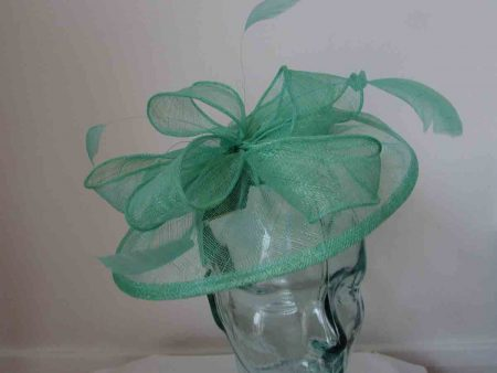 Sinamay fascinator with feathers in miami green