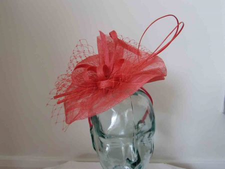 Simanay fascinator with double quill in tangerine