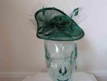 Twisted sinamay fascinator in emerald green