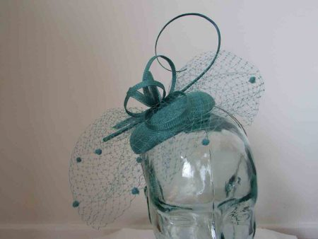 Pillbox  fascinator with netted detail in teal