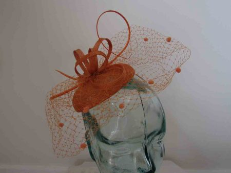Pillbox  fascinator with netted detail in tan orange